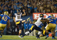 California punter Cole Leininger kicks the ball during the game against UCLA at Rose Bowl in Pasadena, California on October 12th, 2013.   UCLA defeated California, 37-10.