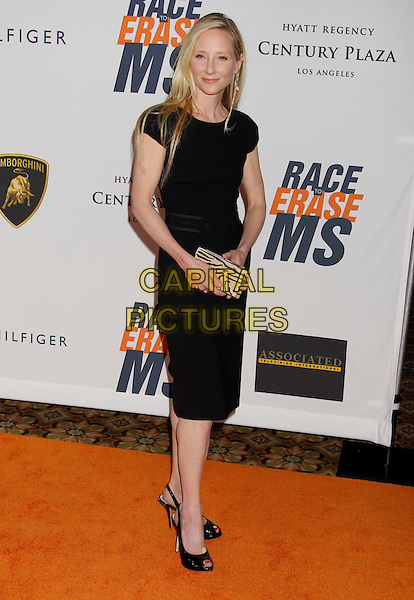 ANNE HECHE .17th Annual Race To Erase MS. Held at the Hyatt Regency Century Plaza Hotel,   Century City, California, USA, .May 7th 2010..full length dress shoes slingbacks peep toe zebra animal print clutch bag black .CAP/ADM/MJ.©Michael Jade/AdMedia/Capital Pictures.