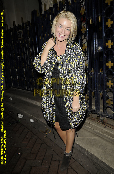 "SHERIDAN SMITH.""Blowing Whistles"" press night, Leicester Square theatre, Leicester Square, London, England..October 23rd, 2008.full length black coat jacket dress white yellow pattern print ankle boots silver trim .CAP/CAN.©Can Nguyen/Capital Pictures."