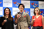 """April 19, 2018, Tokyo, Japan - Japanese actor Mokomichi Hayami (C) smiles with Bordeaux winery staffs Pauline Dufour (L) and Melanie Cisneros (R) at a promotional event of French Bordeaux wines in Tokyo on Thursday, April 19, 2018. Bordeaux wine bureau C.I.V.B. will have a three-day event """"My Bordeaux Party"""" to provide 100 selected brands Bordeaux wines with 300yen for a glass at a pop-up bar from April 20.  (Photo by Yoshio Tsunoda/AFLO) LWX -ytd-"""