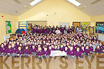 Students from Gaelscoil Faithleann Killarney who presented a cheque of EUR3604 to Simon Shaw in aid of his Haven building project for Haiti at the school on Friday