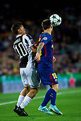 12th September 2017, Camp Nou, Barcelona, Spain; UEFA Champions League Group stage, FC Barcelona versus Juventus; Leo Messi of FC Barcelona and Paulo Dybala of Juventus fight the ball