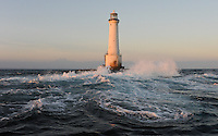 Waves rip around the dangerous shoals of Great Basses Reef Lighthouse, offshore southwestern Sri Lanka.