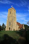 Church tower with flag blue sky, church of Saint Margaret, Shottisham, Suffolk, England, UK