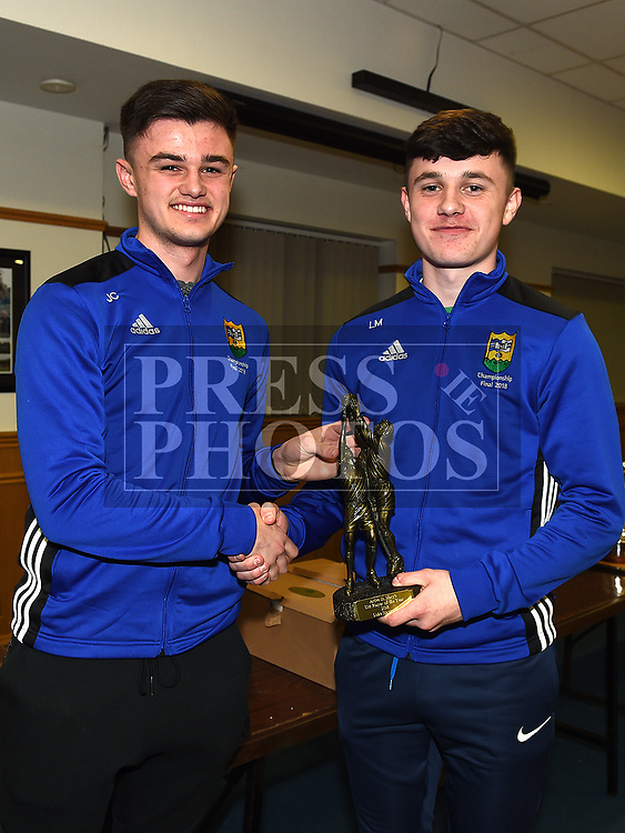 Luke Matthews is presented with the under 16 Player of the Year award by Jonathan Commons at the St. Mary's juvenile awards night. Photo:Colin Bell/pressphotos.ie