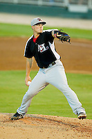 Hickory Crawdads relief pitcher Tyler Smith (14) in action against the Kannapolis Intimidators at CMC-Northeast Stadium on July 26, 2013 in Kannapolis, North Carolina.  The Intimidators defeated the Crawdads 2-1.  (Brian Westerholt/Four Seam Images)