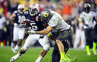 Jan 10, 2011; Glendale, AZ, USA; Auburn Tigers running back Michael Dyer (5) is tackled short of the goal line by Oregon Ducks safety John Boyett (20) during the fourth quarter of the 2011 BCS National Championship game at University of Phoenix Stadium.  Mandatory Credit: Mark J. Rebilas-