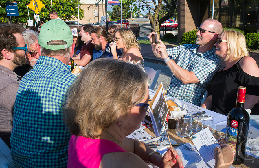 NWA Democrat-Gazette/CHARLIE KAIJO (from right) Karen and Kelly Beers of Fayetteville take a selfie, Saturday, June 9, 2018 on Emma Ave. in Springdale. <br /><br />Back for its 3rd year, this popular event brought hundreds of guests together for a lively, friendly community dinner of multiple courses served under the night sky—right down the middle of Emma Avenue. Past attendees raved about the special experience of dining al fresco with family and friends, as well as meeting new neighbors.
