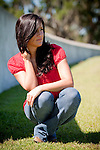 american indian girl posing in red shirt
