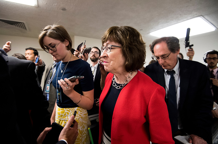 UNITED STATES - JULY 10: Reporters swarm Sen. Susan Collins, R-Maine, as she arrives for the Senate Republicans' policy lunch in the Capitol on Tuesday, July 10, 2018, the day after President Donald Trump nominated Brett Kavanaugh to the Supreme Court. (Photo By Bill Clark/CQ Roll Call)