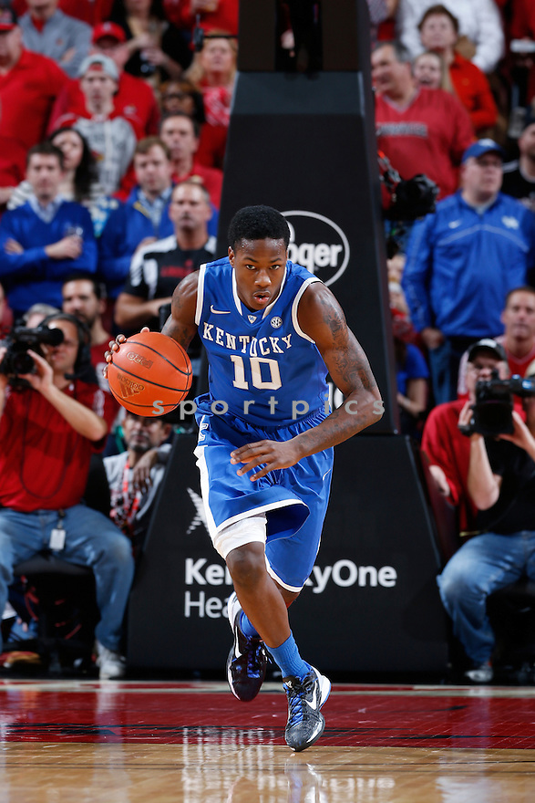 LOUISVILLE, KY - DECEMBER 29: Archie Goodwin #10 of the Kentucky Wildcats brings the ball up court against the Louisville Cardinals during the game at KFC Yum! Center on December 29, 2012 in Louisville, Kentucky. Louisville won 80-77. Archie Goodwin