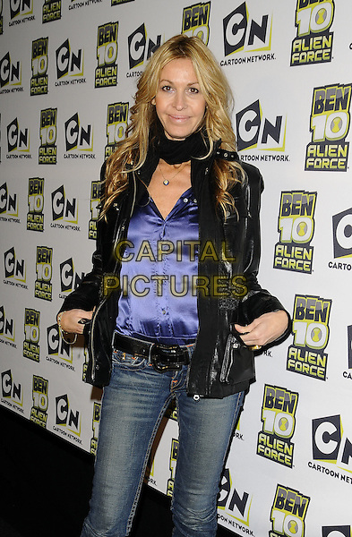 "MELISSA ODABASH.The ""Ben 10: Alien Force"" VIP premiere, Old Billingsgate Market, Old Billingsgate Walk, London, England..February 15th, 2009.half 3/4 length jeans denim jacket purple blue silk satin shirt top scarf leather .CAP/CAN.©Can Nguyen/Capital Pictures."