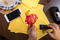 Karonika Brown, 34, makes a paper lantern craft during a Lunar New Year celebration in the Asian American Connections Center at Middlesex Community College in Lowell, Mass., USA, on Thurs., Feb. 15, 2018. Brown graduated with a degree with an Associates Degree in Liberal Arts and Sciences from Middlesex Community College in 2016, and continues to take classes there and work as a writing tutor for other students. Brown is an immigrant from Cambodia. The Asian American Connections Center was established at the school using a federal grant in 2016 and serves as a focal point for the Asian community at the school, predominantly Cambodian, to gather, socialize, study, and otherwise take part in student life.