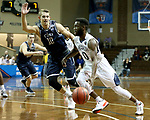 SIOUX FALLS, SD - MARCH 20: Ike Agusi #0 from Queens University gets a step past Jason Todd #10 from Cal Baptist during their quarterfinal game at the 2018 Elite Eight Men's NCAA DII Basketball Championship at the Sanford Pentagon in Sioux Falls, SD. (Photo by Dave Eggen/Inertia)