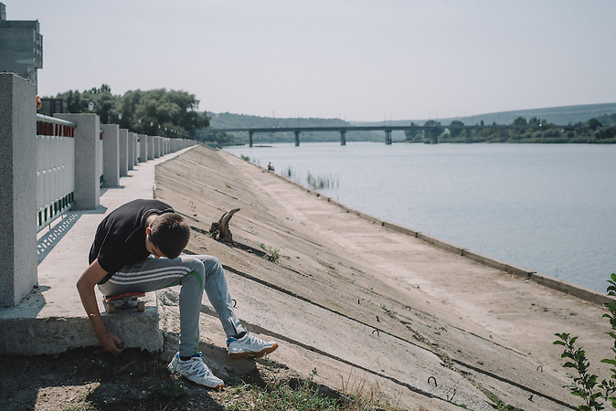 Nikita during his skateboard ride along river bank. Ribnita, Transnistria