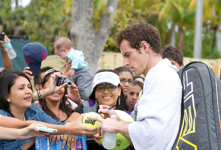 Andy Murray (GBR) signs autographs for fans during practice for his First round match<br /> <br /> Photographer Andrew Patron<br /> <br /> Tennis - Sony Open Tennis - ATP World Tour Masters 1000 - Day 2 - Tuesday 18th March 2014 - Tennis Center at Crandon Park Key Biscayne, Miami, Florida USA<br /> <br /> &copy; CameraSport - 43 Linden Ave. Countesthorpe. Leicester. England. LE8 5PG - Tel: +44 (0) 116 277 4147 - admin@camerasport.com - www.camerasport.com