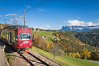 """Italy, Alto Adige-Trentino (South Tyrol), Renon, Soprabolzano: narrow gauge railway Ferrovia del Renon (Rittner Bahnl) connects with Collalbo (Klobenstein) and Maria Assunta, at background snowcapped Sciliar   Italien, Suedtirol, Alto Adige-Trentino, Oberbozen auf dem Ritten: Das """"Rittner Bahnl"""", eine Schmalspurbahn, verbindet Oberbozen mit Klobenstein und Maria Himmelfahrt, im Hintergrund der schneebedeckte Schlern"""