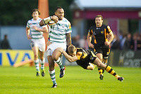 130712 Copyright onEdition 2012 ©.Free for editorial use image, please credit: onEdition..Sailosi Tagicakibau of London Irish is tackled by Danny Wells of London Wasps at The Stoop, Twickenham in the first round of The J.P. Morgan Asset Management Premiership Rugby 7s Series...The J.P. Morgan Asset Management Premiership Rugby 7s Series kicked off again for the third season on Friday 13th July at The Stoop, Twickenham with Pool B being played at Edgeley Park, Stockport on Friday, 20th July, Pool C at Kingsholm Gloucester on Thursday, 26th July and the Final being played at The Recreation Ground, Bath on Friday 3rd August. The innovative tournament, which involves all 12 Premiership Rugby clubs, offers a fantastic platform for some of the country's finest young athletes to be exposed to the excitement, pressures and skills required to compete at an elite level...The 12 Premiership Rugby clubs are divided into three groups for the tournament, with the winner and runner up of each regional event going through to the Final. There are six games each evening, with each match consisting of two 7 minute halves with a 2 minute break at half time...For additional images please go to: http://www.w-w-i.com/jp_morgan_premiership_sevens/..For press contacts contact: Beth Begg at brandRapport on D: +44 (0)20 7932 5813 M: +44 (0)7900 88231 E: BBegg@brand-rapport.com..If you require a higher resolution image or you have any other onEdition photographic enquiries, please contact onEdition on 0845 900 2 900 or email info@onEdition.com.This image is copyright the onEdition 2012©..This image has been supplied by onEdition and must be credited onEdition. The author is asserting his full Moral rights in relation to the publication of this image. Rights for onward transmission of any image or file is not granted or implied. Changing or deleting Copyright information is illegal as specified in the Copyright, Design and Patents Act 1988. If you are in any way unsure of your right to publish