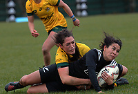 Kiri Lingman tackles Kristina Sue during the 2017 International Women's Rugby Series rugby match between the NZ Black Ferns and Australia Wallaroos at Rugby Park in Christchurch, New Zealand on Tuesday, 13 June 2017. Photo: Dave Lintott / lintottphoto.co.nz