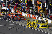 12-13 February, 2016, Daytona Beach, Florida, USA<br /> Matt Kenseth, Dollar General Toyota Camry and Carl Edwards, Arris Toyota Camry make pit stops.<br /> ©2016, F. Peirce Williams