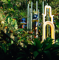 Lush vegetation engulfs Edward James' colourful installations in the pleasure garden of Las Pozas