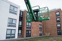 Construction equipment stands outside Gurney's Newport Resort and Marina, which was formerly a Hyatt Regency hotel, on Goat Island in Newport, Rhode Island, on Wed., April 19, 2017. The exterior is being repaired and will soon be painted to give the hotel an updated look. The entire hotel will be renewed with an approximately $18 million renovation to be completed by Memorial Day 2017.