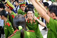 A young female Police trainee giving the V-for-Victory sign so commonly used in Vietnam. Tay Ninh, Vietnam