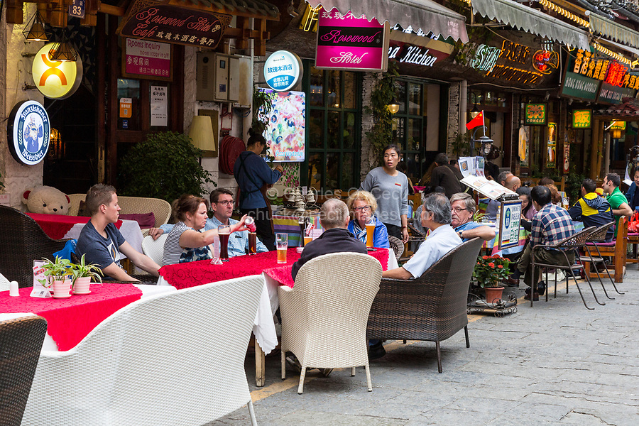 Yangshuo, China.  Tourists at a Restaurant with Outdoor Dining.