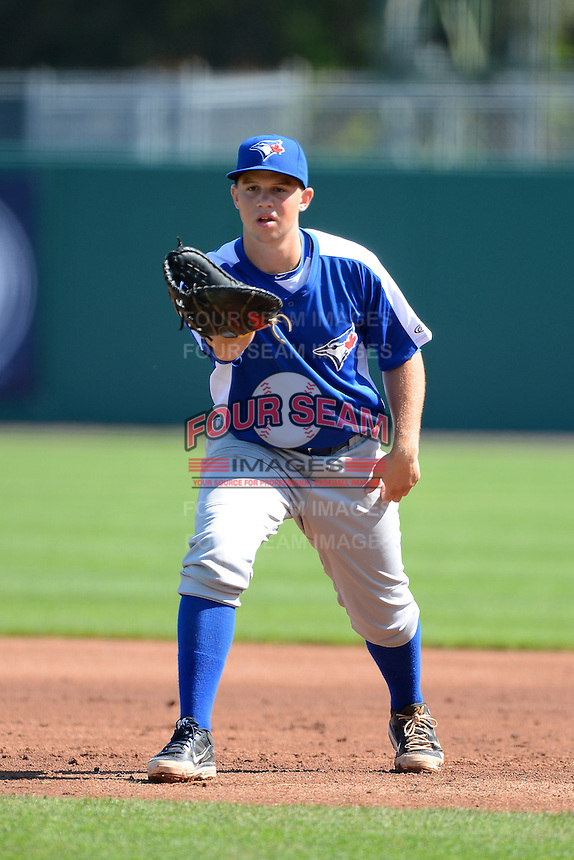Braxton Davidson (23) of T.C. Roberson High School in Asheville, North Carolina playing for the Toronto Blue Jays scout team during the East Coast Pro Showcase on August 2, 2013 at NBT Bank Stadium in Syracuse, New York.  (Mike Janes/Four Seam Images)