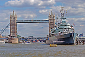 London, GBR - August 7, 2005 -- View of the Tower Bridge and the HMS Belfast from a ferry in the middle of the Thames River in London, Great Britain on August 7, 2005.  .Credit: Ron Sachs / CNP