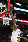27 November 2015: NC State's Lennard Freeman (1) shoots over Winthrop's Duby Okeke (0). The North Carolina State University of North Carolina Wolfpack hosted the Winthrop University Eagles at the PNC Arena in Raleigh, North Carolina in a 2015-16 NCAA Division I Men's Basketball game. NC State won the game 87-79.