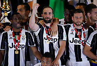 Juventus ' Gonzalo Higuain   celebrate after win the Italian Cup Final  football match against Lazio at  the Olympic stadium in Rome, Italy on the 17th May 2017
