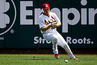 Kyle Conley (35) of the Springfield Cardinals fields a ground ball in right field during a game against the Arkansas Travelers at Hammons Field on May 8, 2012 in Springfield, Missouri. (David Welker/ Four Seam Images)