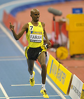 Photo: Ady Kerry/Richard Lane Photography..Aviva Grand Prix. 21/02/2009. .Mo Farah celebrates as he crosses the line to win the 3000m in a new British Record time