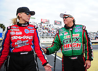 Mar. 10, 2012; Gainesville, FL, USA; NHRA funny car driver John Force (right) with daughter Courtney Force during qualifying for the Gatornationals at Auto Plus Raceway at Gainesville. Mandatory Credit: Mark J. Rebilas-