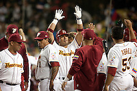 21 March 2009:  #2 Carlos Guillen of Venezuela celebrates with teammates after hitting a home run in the seventh inning during the 2009 World Baseball Classic semifinal game at Dodger Stadium in Los Angeles, California, USA. Korea wins 10-2 over Venezuela.