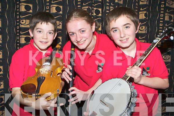 Cian O'Sullivan, Mary and Sean Kelliher Fossa who competed at the Sco?r na nO?g finals in the Gleneagle Hotel Killarney on Sunday..