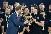 Richie McCaw of New Zealand is handed the trophy by Prince Harry after the match. Rugby World Cup Final between New Zealand and Australia on October 31, 2015 at Twickenham Stadium in London, England. Photo by: Patrick Khachfe / Onside Images