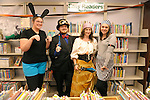 Library employees Sena Lloyd, left, Aubrey White, Naomi Morgan and Heather Butler pose at the Carson City Library Monday, Oct. 27, 2014. As part of the library's Halloween festivities, dozens of children decorated pumpkins or gourds and took part in a costume contest.