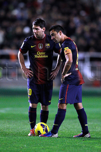 27.10.2012 Vallecano, Spain.  Spainish La Liga football.  Rayo Vallecano vs  F.C. Barcelona (0-5) at Campo de Vallecas stadium. The picture shows Lionel Andres Messi (Argentine forward of Barcelona) and  Xavier Hernandez Creus (Spanish midfielder of Barcelona)