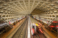 A subway train creates a blur as it leaves the Farragut West station of the Washington DC metro.