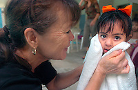 California Avenue School Instructor's aids Kitty Freeman dries off  3 year old Celete Ramos after a swim at the therapy pool. Jamie Scott Lytle Photography