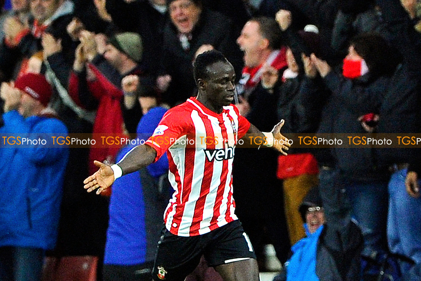 Sadio Mane of Southampton celebrates scoring the first goal - Southampton vs Arsenal - Barclays Premier League Football at St Mary's Stadium, Southampton, Hampshire - 01/01/15 - MANDATORY CREDIT: Denis Murphy/TGSPHOTO - Self billing applies where appropriate - contact@tgsphoto.co.uk - NO UNPAID USE