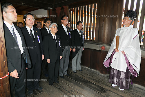 A group of lawmakers, including Hidehisa Otsuji (center), a former health minister, follow a Shinto priest to pay their respects to the war dead at Yasukuni Shrine on the 71st anniversary of Japan's surrender in World War II on August 15, 2016, Tokyo, Japan. Some 70 lawmakers visited the Shrine to pay their respects, but the Prime Minister Shinzo Abe did not visit the controversial symbol and instead sent a ritual offering to a shrine. Yasukuni enshrines the war dead including war criminals and as such visits by Japanese  politicians tend to provoke anger from neighbors China and Korea that suffered from Japan's militarist past. (Photo by Rodrigo Reyes Marin/AFLO)
