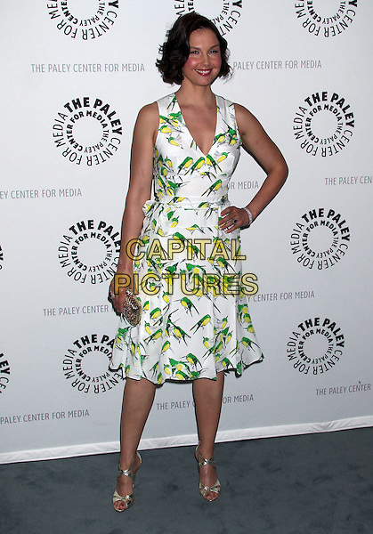 "Ashley Judd.""Missing"" Premiere Screening presented by The Paley Center for Media held at The Paley Center For Media, Beverly Hills, California, USA..April 10th, 2012.full length white green print dress bird birds gold clutch bag hand on hip.CAP/ADM/RE.©Russ Elliot/AdMedia/Capital Pictures."
