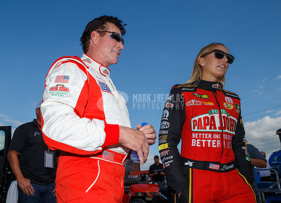 Sep 2, 2016; Clermont, IN, USA; Papa Johns pizza founder John Schnatter (left) with NHRA top fuel driver Leah Pritchett during qualifying for the US Nationals at Lucas Oil Raceway. Mandatory Credit: Mark J. Rebilas-USA TODAY Sports