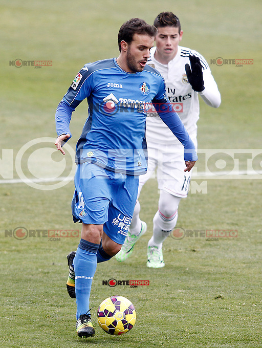 Getafe's Pedro Leon (l) and Real Madrid's James Rodriguez during La Liga match.January 18,2013. (ALTERPHOTOS/Acero) /NortePhoto<br /> NortePhoto.com