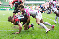 20120823 Copyright onEdition 2012©.Free for editorial use image, please credit: onEdition..Owen Farrell of Saracens scores a try despite the tackle of Hugo Bonneval of Stade Francais Paris at The Honourable Artillery Company, London in the pre-season friendly between Saracens and Stade Francais Paris...For press contacts contact: Sam Feasey at brandRapport on M: +44 (0)7717 757114 E: SFeasey@brand-rapport.com..If you require a higher resolution image or you have any other onEdition photographic enquiries, please contact onEdition on 0845 900 2 900 or email info@onEdition.com.This image is copyright the onEdition 2012©..This image has been supplied by onEdition and must be credited onEdition. The author is asserting his full Moral rights in relation to the publication of this image. Rights for onward transmission of any image or file is not granted or implied. Changing or deleting Copyright information is illegal as specified in the Copyright, Design and Patents Act 1988. If you are in any way unsure of your right to publish this image please contact onEdition on 0845 900 2 900 or email info@onEdition.com