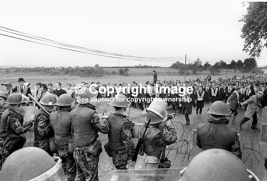 Orangemen defying a N Ireland Government parade ban in Dungiven, Co Londonderry, UK, are halted by British soldiers in riot gear. Ref: 197106130220a<br />