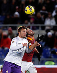 Calcio, Serie A: Roma vs Fiorentina. Roma, stadio Olimpico, 8 dicembre 2012..Fiorentina forward Haris Seferovic, of Switzerland, left, and AS Roma midfielder Miralem Pjanic, of Bosnia, fight for the ball during the Italian Serie A football match between AS Roma and Fiorentina at Rome's Olympic stadium, 8 december 2012..UPDATE IMAGES PRESS/Isabella Bonotto
